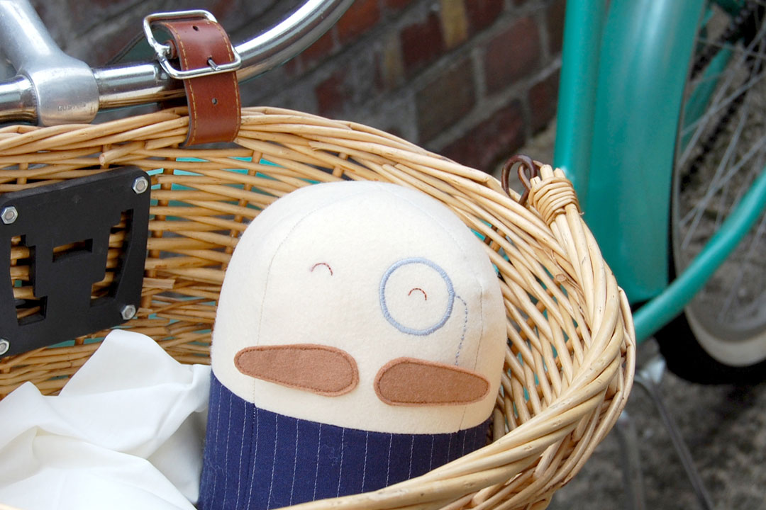 Photo of a SewSew door-stop in the shopping basket of a bicycle & SewSew \u2013 Fieldwork